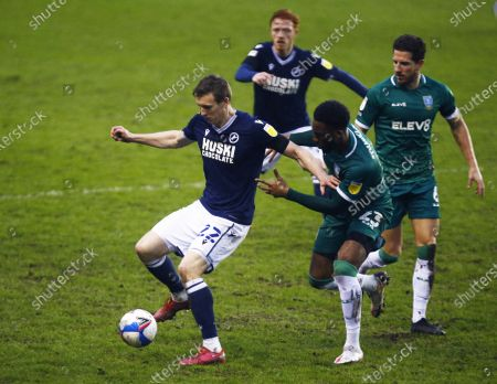 L-R Jon Dadi Bodvarsson of Millwall holds of Sheffield Wednesday's Chey Dunkley during The Sky Bet Championship between Millwall and Sheffield Wednesday at The Den Stadium, London on 06th February, 2021 (Photo by Action Foto Sport/NurPhoto)