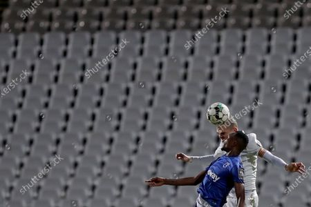 Pepe of FC Porto (R ) vies with Cafu Phete of Belenenses SAD during the Portuguese League football match between Belenenses SAD and FC Porto at Jamor stadium in Oeiras, Portugal on February 4, 2021. (Photo by Pedro Fiúza/NurPhoto)