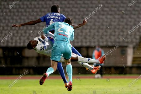 Stock Image of Nanu of FC Porto (L ) fights for the ball with Belenenses SAD's goalkeeper Stanislav Kritciuk (R ) and Bruno Ramires during the Portuguese League football match between Belenenses SAD and FC Porto at Jamor stadium in Oeiras, Portugal on February 4, 2021. (Photo by Pedro Fiúza/NurPhoto)