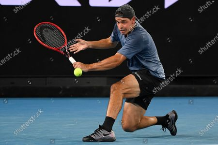 Australia's Alex Bolt makes a forehand return to Bulgaria's Grigor Dimitrov during their second round match at the Australian Open tennis championship in Melbourne, Australia