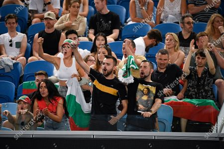 Fans of Bulgaria's Grigor Dimitrov cheers him on during second round match against Australia's Alex Bolt at the Australian Open tennis championship in Melbourne, Australia