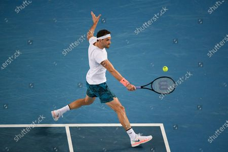 Stock Image of Bulgaria's Grigor Dimitrov makes a backhand return to Australia's Alex Bolt during their second round match at the Australian Open tennis championship in Melbourne, Australia