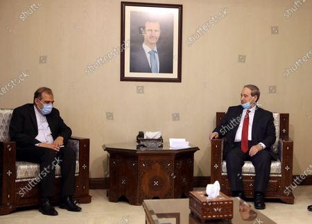 Syrian Foreign Minister Faisal Mekdad (R) meets with special assistant to Iranian foreign minister for special political affairs Ali Asghar Khaji (L), in Damascus, Syria, 10 February 2021. Syrian President Bashar Al-Assad met earlier with Khaji, during which the two sides discussed bilateral cooperation especially in the economic arena.
