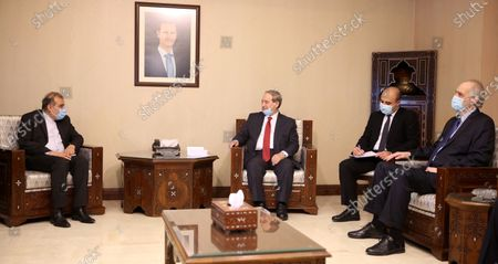 Syrian Foreign Minister Faisal Mekdad (2-L) meets with special assistant to Iranian foreign minister for special political affairs Ali Asghar Khaji (L), in Damascus, Syria, 10 February 2021. Syrian President Bashar Al-Assad met earlier with Khaji, during which the two sides discussed bilateral cooperation especially in the economic arena.