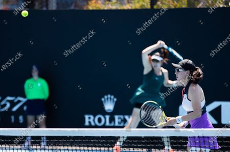Stock Image of Zheng Saisai/Duan Yingying (L) compete during the women's doubles first round match between China's Zheng Saisai/Duan Yingying and Serbia's Aleksandra Krunic/Italy's Martina Trevisan at the Australian Open in Melbourne Park, Melbourne, Australia on Feb. 10, 2021.