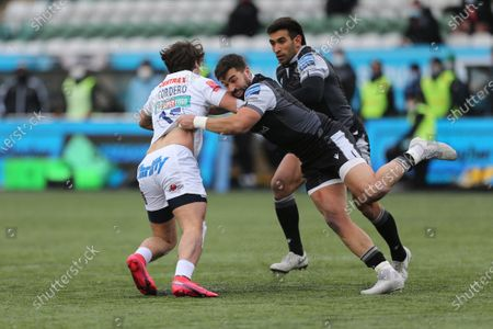 Gareth Owen and Matias Orlando attempt to stop a break Facundo Cordero of Exeter Chiefs  during the Gallagher Premiership match between Newcastle Falcons and Exeter Chiefs at Kingston Park, Newcastle on Sunday 7th February 2021.  (Photo by Chris Lishman/MI News/NurPhoto)
