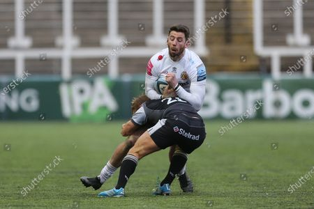 Cooper Vuna of Newcastle Falcons stops Exeter Chiefs' Alex Cuthbert  during the Gallagher Premiership match between Newcastle Falcons and Exeter Chiefs at Kingston Park, Newcastle on Sunday 7th February 2021.  (Photo by Chris Lishman/MI News/NurPhoto)