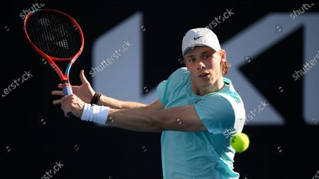 Canada's Denis Shapovalov makes a forehand return to Australia's Bernard Tomic during their second round match at the Australian Open tennis championship in Melbourne, Australia