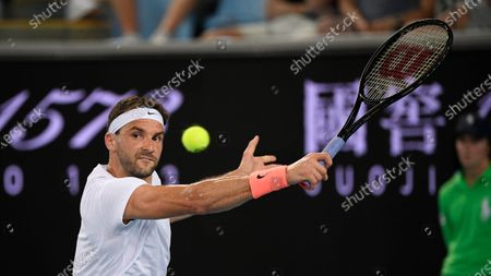 Stock Picture of Bulgaria's Grigor Dimitrov makes a backhand return to Australia's Alex Bolt during their second round match at the Australian Open tennis championship in Melbourne, Australia