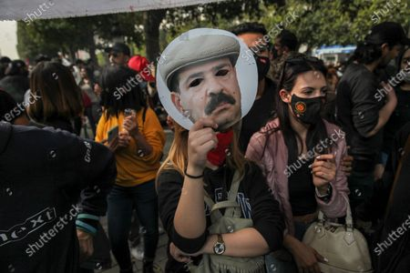 A female protester lifts a mask of Chokri Belaid as she took part in a rally held on avenue Habib Bourguiba in the capital Tunis in commemoration of the 8th anniversary of the assassination of the leftist opposition politician Chokri Belaid to call for uncovering the truth about the assassination of Chokri Belaid.Demonstrators also protested against police repression and demanded the release of young people arrested by the security forces. Some young protesters called for the decriminalization of Cannabis and soft drugs, and some others called for the fall of the government of the Prime Minister Hichem Mechichi and chanted slogans against Rached Ghannouchi, the president of the Islamist party Ennahda.