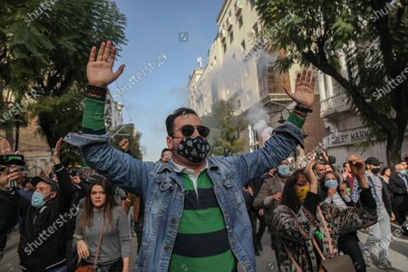 A Tunisian protester raises two arms as he takes part in a march towards avenue Habib Bourguiba in the capital Tunis in commemoration of the 8th anniversary of the assassination of the leftist opposition politician Chokri Belaid to call for uncovering the truth about the assassination of Chokri Belaid.Demonstrators also protested against police repression and demanded the release of young people arrested by the security forces. Some young protesters called for the decriminalization of Cannabis and soft drugs, and some others called for the fall of the government of the Prime Minister Hichem Mechichi and chanted slogans against Rached Ghannouchi, the president of the Islamist party Ennahda.