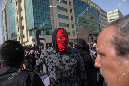 A protester wearing a mask takes part in a rally held in the capital Tunis in commemoration of the 8th anniversary of the assassination of the leftist opposition politician Chokri Belaid to call for uncovering the truth about the assassination of Chokri Belaid.Demonstrators also protested against police repression and demanded the release of young people arrested by the security forces. Some young protesters called for the decriminalization of Cannabis and soft drugs, and some others called for the fall of the government of the Prime Minister Hichem Mechichi and chanted slogans against Rached Ghannouchi, the president of the Islamist party Ennahda.