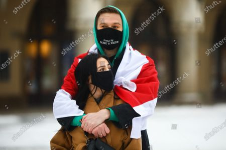 Stock Photo of People gathered at the Main Square to demonstrate on the Day of Solidarity with Belarus. Krakow, Poland on February 7, 2021.