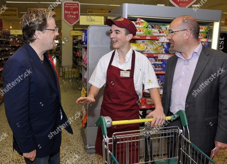A shop worker at Morrisons with comedian Eddie Izzard and MP Jim Knight
