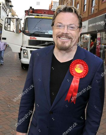 Eddie Izzard smiling after the truck was halted by one of the operatives