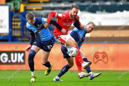 Glenn Murray (25) of Nottingham Forest battles with Josh Knight and Jack Grimmer of Wycombe Wanderers