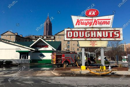 Firefighters work at the Krispy Kreme Doughnuts store in Atlanta on . The historic store was engulfed in flames early Wednesday. The store owned by Basketball Hall-of-Famer Shaquille O'Neal was significantly damaged