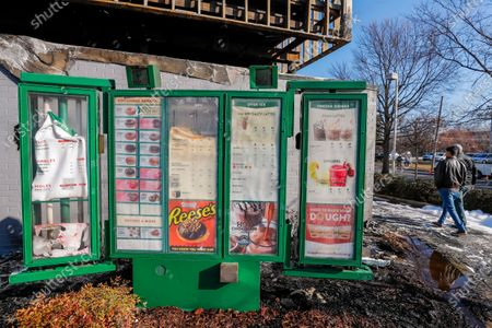 The melted drive-thru menu outside the historic Krispy Kreme Doughnuts after an overnight fire destroyed the iconic restaurant in Atlanta, Georgia, USA, 10 February 2021. The 60-year-old Atlanta institution was purchased by NBA Hall of Famer Shaquille O'Neal in 2016. No injuries were reported in the Krispy Kreme fire, which was open at the time.