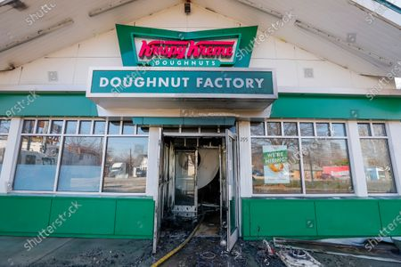 The damaged front entrance of the historic Krispy Kreme Doughnuts after an overnight fire destroyed the iconic restaurant in Atlanta, Georgia, USA, 10 February 2021. The 60-year-old Atlanta institution was purchased by NBA Hall of Famer Shaquille O'Neal in 2016. No injuries were reported in the Krispy Kreme fire, which was open at the time.