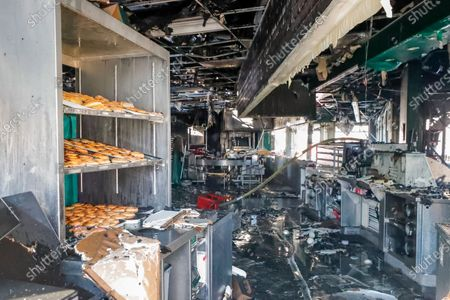 Stock Photo of Fire-damaged doughnuts are visible through the drive-thru window of the historic Krispy Kreme Doughnuts after an overnight fire destroyed the iconic restaurant in Atlanta, Georgia, USA, 10 February 2021. The 60-year-old Atlanta institution was purchased by NBA Hall of Famer Shaquille O'Neal in 2016. No injuries were reported in the Krispy Kreme fire, which was open at the time.
