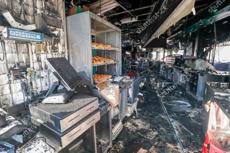 Editorial picture of Krispy Kreme Doughnuts fire destroys iconic eatery owned by Shaquille O'Neal., Atlanta, USA - 10 Feb 2021