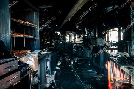 Stock Picture of The interior of a burned Krispy Kreme Doughnuts store in seen in Atlanta on . The historic store was engulfed in flames early Wednesday. The store owned by Basketball Hall-of-Famer Shaquille O'Neal was significantly damaged