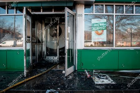 The front entrance to a burned Krispy Kreme Doughnuts store in seen in Atlanta on . The historic store was engulfed in flames early Wednesday. The store owned by Basketball Hall-of-Famer Shaquille O'Neal was significantly damaged