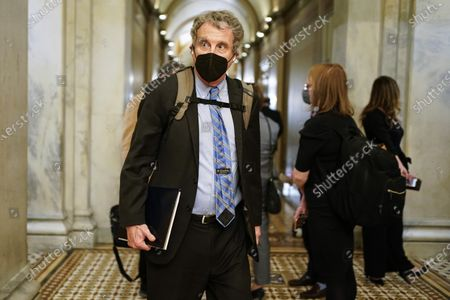 Sen. Sherrod Brown, D-Ohio, leaves at the end of the day of second impeachment trial of former President Donald Trump, at the Capitol, in Washington