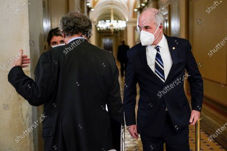 Sen. Bob Casey, D-Pa., walks past Sen. Sherrod Brown, D-Ohio, during a break in the second impeachment trial of former President Donald Trump, at the Capitol, in Washington