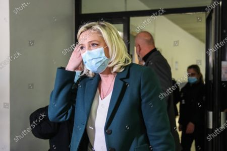 Stock Image of French member of Parliament and president of the Rassemblement National far-right party Marine Le Pen leaves the court after a trial at the Tribunal De Grande Instance, in Nanterre, a Paris suburb, France, 10 February 2021. Marine Le Pen and Gilbert Collard, a party colleague, face charges of breaking hate speech laws by tweeting pictures of Islamic State (ISIS) atrocities in 2015.
