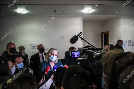 French member of Parliament and president of the Rassemblement National far-right party Marine Le Pen (C) talks to the press after a trial at the Tribunal De Grande Instance, in Nanterre, a Paris suburb, France, 10 February 2021. Marine Le Pen and Gilbert Collard, a party colleague, face charges of breaking hate speech laws by tweeting pictures of Islamic State (ISIS) atrocities in 2015.