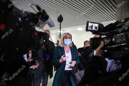 Stock Picture of French member of Parliament and president of the Rassemblement National far-right party Marine Le Pen (C) talks to the press after a trial at the Tribunal De Grande Instance, in Nanterre, a Paris suburb, France, 10 February 2021. Marine Le Pen and Gilbert Collard, a party colleague, face charges of breaking hate speech laws by tweeting pictures of Islamic State (ISIS) atrocities in 2015.