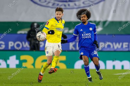 Adam Lallana (14) of Brighton & Hove Albion and Hamza Choudhury (20) of Leicester City during the FA Cup 5th round match between Leicester City and Brighton and Hove Albion at the King Power Stadium, Leicester
