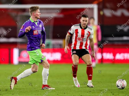 Taylor Moore of Bristol City is challenged by Billy Sharp of Sheffield United