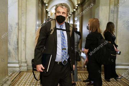 Senator Sherrod Brown (C) departs after the day's proceedings concluded in the impeachment trial of former US President Donald Trump, on charges of inciting the deadly attack on the US Capitol, on Capitol Hill in Washington, DC, USA, 10 February 2021.