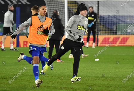 Leicester's Youri Tielemans, left, and Leicester's Jamie Vardy warm up prior to the English FA Cup fifth round soccer match between Leicester City and Brighton and Hove Albion at the King Power Stadium in Leicester, England