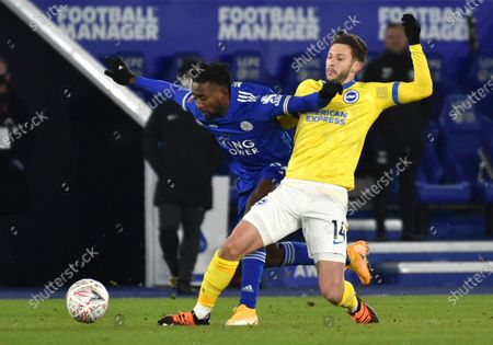 Stock Image of Leicester's Wilfred Ndidi, left, and Brighton's Adam Lallana challenge for the ball during the English FA Cup fifth round soccer match between Leicester City and Brighton and Hove Albion at the King Power Stadium in Leicester, England