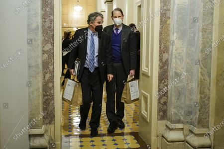 U.S. Senators' Sherrod Brown (D-OH) and Ron Wyden (D-OR) walk during a break in the impeachment trial of former U.S. President Donald Trump, on charges of inciting the deadly attack on the U.S. Capitol, on Capitol Hill in Washington, U.S.,.