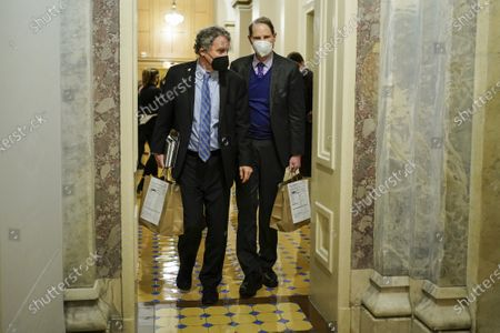 Senators' Sherrod Brown (D-OH) and Ron Wyden (D-OR) walk during a break in the impeachment trial of former U.S. President Donald Trump, on charges of inciting the deadly attack on the U.S. Capitol, on Capitol Hill