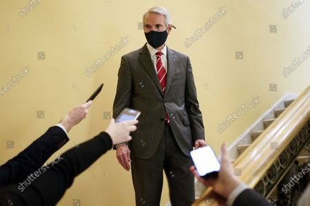 Stock Image of Senator Robert Portman (R-OH) speaks with reporters during a break in the impeachment trial of former U.S. President Donald Trump, on charges of inciting the deadly attack on the U.S. Capitol, on Capitol Hill