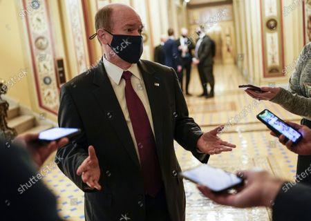 Stock Photo of Sen. Christopher A. Coons, D-Del., speaks to the media during a break in the impeachment trial of former President Donald Trump on Capitol Hill