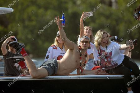 Tampa Bay Buccaneers NFL football tight end Rob Gronkowski waves during a celebration of their Super Bowl 55 victory over the Kansas City Chiefs with a boat parade in Tampa, Fla