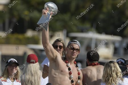 Tampa Bay Buccaneers NFL football tight end Rob Gronkowski holds up the Vince Lombardi trophy during a celebration of their Super Bowl 55 victory over the Kansas City Chiefs with a boat parade in Tampa, Fla