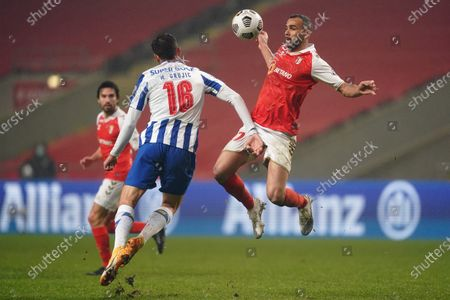 Sporting de Braga`s Fransérgio (R) fighs for the ball with FC Porto`s Marko Grujic during the Portuguese Cup semi final, first leg soccer match between Sporting Braga and FC Porto Braga, Portugal, 10 February 2021.