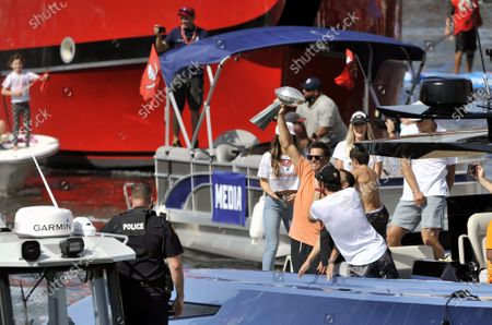 Tampa Bay Buccaneers quarterback Tom Brady holds the Lombardi Trophy as he celebrates their win over the Kansas City Chiefs in Super Bowl LV during a boat parade down the Hillsborough River in Tampa