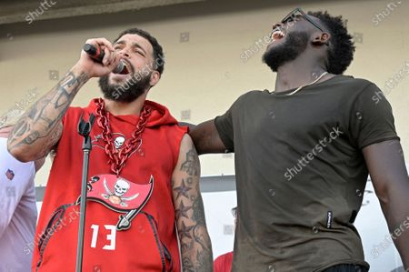 Tampa Bay Buccaneers receivers Mike Evans, left, and Chris Godwin take part in a celebration of the team's Super Bowl 55 victory over the Kansas City Chiefs, following a boat parade, in Tampa, Fla