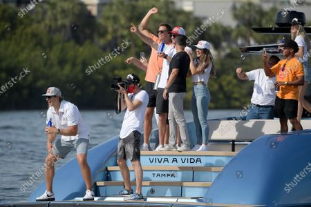 Tampa Bay Buccaneers quarterback Tom Brady, center, cheers during a celebration of their Super Bowl 55 victory over the Kansas City Chiefs with a boat parade, in Tampa, Fla