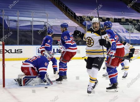 Boston Bruins Anders Bjork (10) scores on New York Rangers' Alexandar Georgiev (40) during the third period of an NHL hockey game, in New York