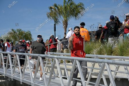 Tampa Bay Buccaneers wide receiver Mike Evans (13) arrives before a celebration of their Super Bowl 55 victory over the Kansas City Chiefs with a boat parade, in Tampa, Fla