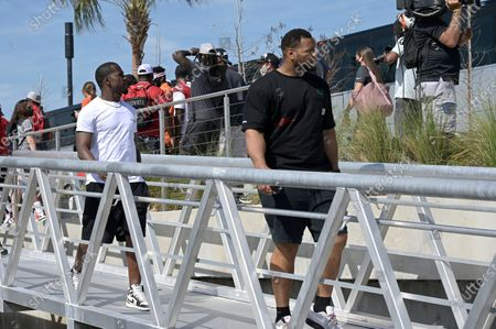Stock Photo of Tampa Bay Buccaneers linebacker Lavonte David, left, and defensive tackle Ndamukong Suh arrive before a celebration of their Super Bowl 55 victory over the Kansas City Chiefs with a boat parade, in Tampa, Fla